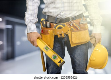 Worker with a tool belt. Isolated over  background.
