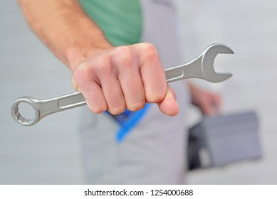 Worker with tools in hand.