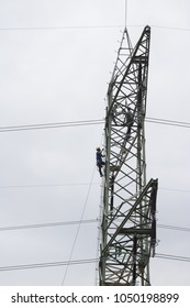 Worker in the tower and voltage