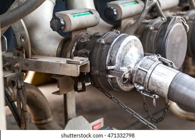 Worker transferring gasoline into filling station gas reservoir