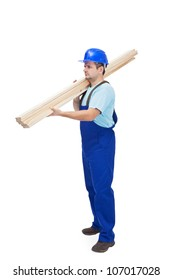 Worker in uniform carries wooden planks - isolated