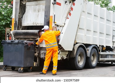 Worker of urban municipal recycling garbage collector truck loading waste and trash bin