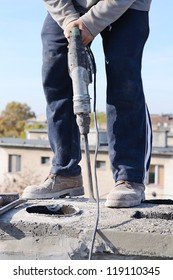 Worker use the breaker hammer on the chimney