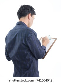 Worker using a clipboard. Sideways. Showing the back. The person is Caucasian and is wearing blue button-down shirt. Isolated. White background.