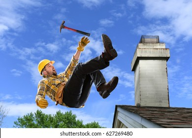 Worker using hammer falling from edge of roof