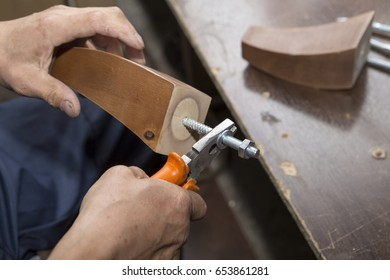 Worker using saw machine to make furniture at carpenters workshop. Handmade business at small furniture factory.