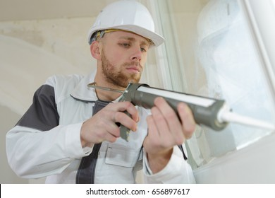 worker using silicone pistol