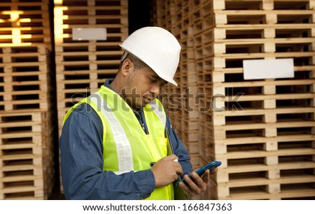 4117345344 Worker Using Smart Phone Warehouse Pallet Stock Photo (Edit Now ...
