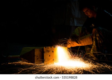 worker is using steel cutting with acetylene torch