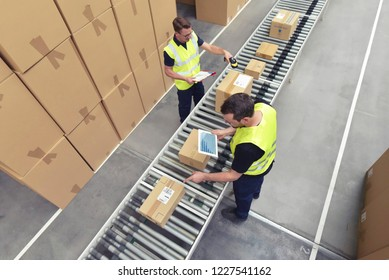 Worker in a warehouse in the logistics sector processing packages on the assembly line  - transport and processing of orders in trade