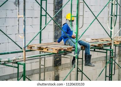 worker wear safty helmet take a break at construction site