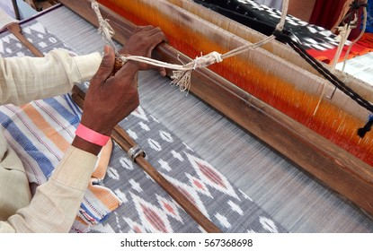 worker weaving hand loom Indian saree or sari,traditional woman dress