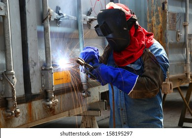 Worker welder container box maintenance in location