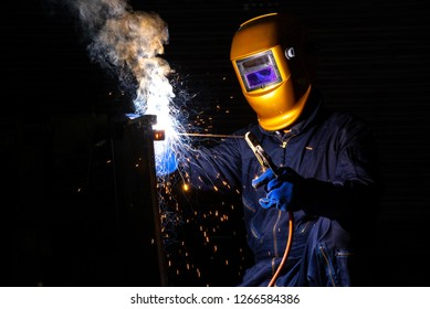 Worker welder working welding steel in industry with safety mask safety gloves and safety equipment. Wolker welding concept.