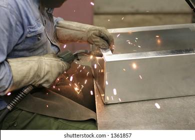 Worker is welding box