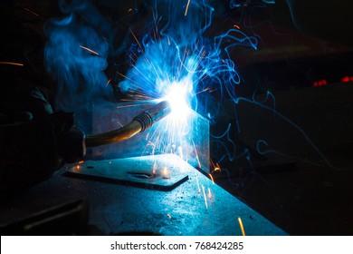 Worker welding construction by MIG welding, Worker welding the steel part by manual, welding splatter repairman, lifestyles, light weld
