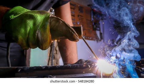 Worker welding the iron