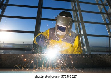 Worker welding metal piping using mix welder/He Work in a Heavy Industry Manufacturer/Industrial worker with protective mask welding inox elements in steel structures manufacture workshop.