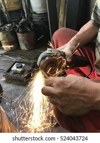 Worker welding metal with sparks