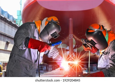 Worker Welding process metal steel pipe with spark light wearing equipment protective Ship repair in shipyard