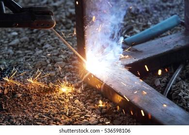 Worker welding a steel