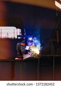 Worker is welding steel in construcktion site.