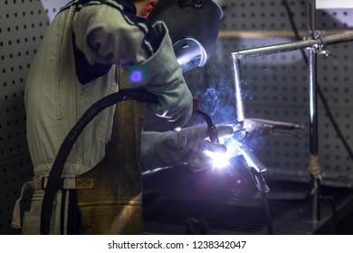 worker is welding steel plate
