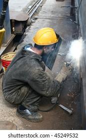 worker welding surface