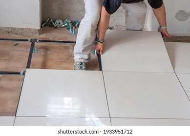 Worker who creates a floating raised floor. Selective focus