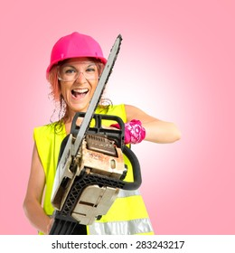 Worker woman with chainsaw over white background