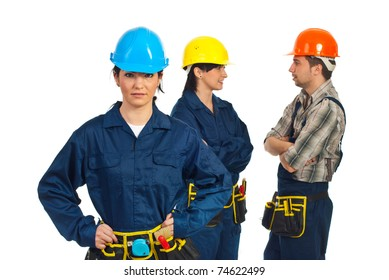 Constructor worker woman in front of camera  and her team of worker having conversation in background