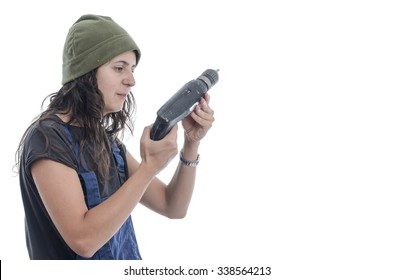 Worker woman with overalls and drill over white background.
