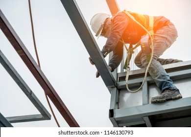 worker work at site construction with yellow helmet safty concept