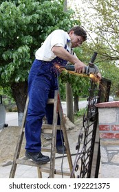 a worker working with Angle Grinder