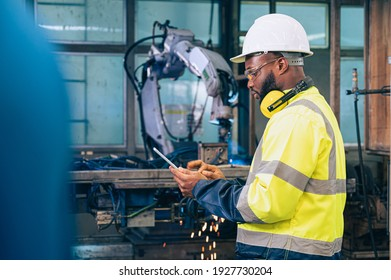 the worker working with automation robot in the factory. the concept of robotics, manufacturing, automotive and industrial