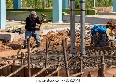 Worker is working for building groundwork.