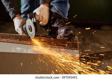 Worker working of a grinding machine