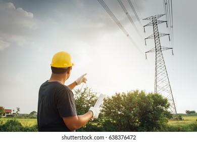 Worker working in high voltage pole