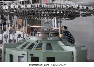 A worker are working on circular knitting machine in a factory in Denizli, on 2 june 2018
