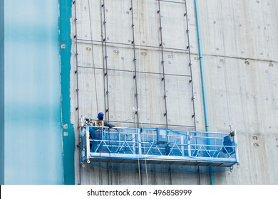 worker working with ourdoor lift outside underconstruction building site for welding metal frame