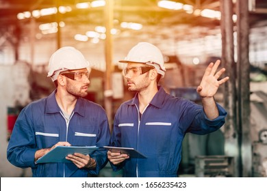 worker working together looking at a boy friend face. Gay men fall in love with friends at work in factory.