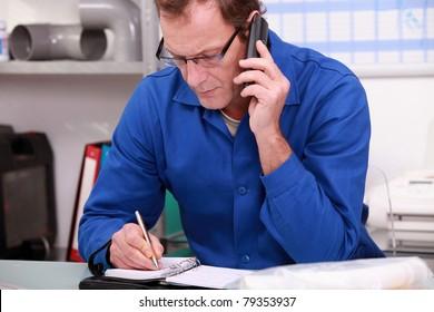 Worker writing in an agenda
