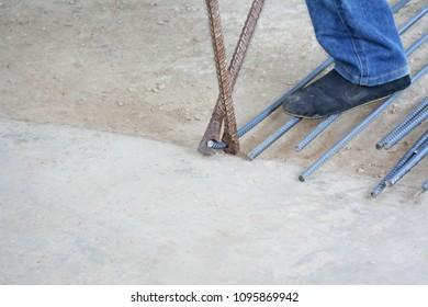 Workers are bending steel with steel bending equipment