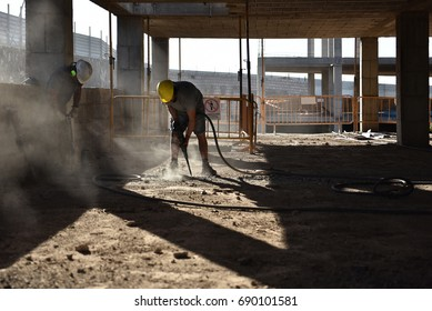 Workers break the concrete with a pneumatic hammer - 2017