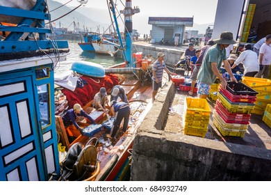 The workers bring fishes to the truck/Qui Nhon, Vietnam - March 26 2017: At the morning, these people were working in Qui Nhon fish market, Qui Nhon city, Vietnam