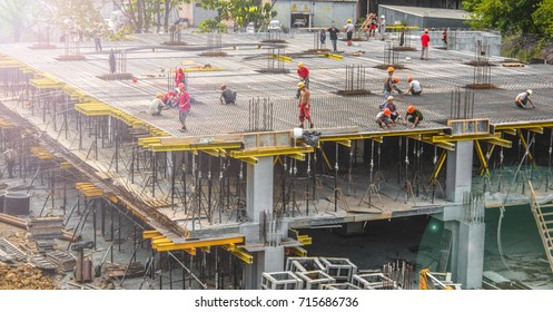 Workers build a building.