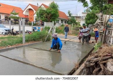 Workers are building concrete roads in the village.Mahasarakham,Thailand,May 4,2017
