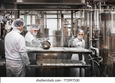 workers at the cheese factory dairy preparing Ricotta cheese at Fico Eataly World in Bologna, Italy 7 Dec 2017