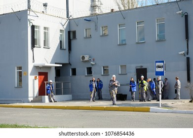 Workers of the Chernobyl Nuclear Power Plant (ChNPP) waiting for a bus on a bus stop near entrance of the Plant. Press-tour to ChNPP for mass-media. April 20, 2018. Chernobyl, Ukraine