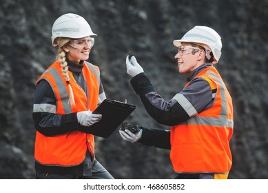 Workers with coal at open pit